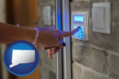 connecticut map icon and woman pressing a key on a home alarm keypad